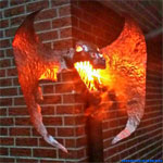 Order work. Outdoor dragon lamp for a house wall.