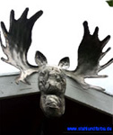 Elk bull head silhouette arched, hammered through with a ball hammer, mounted at gable detailwidth 70 cm.