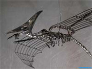 Flight-saurian mobiles wire sculpture.
