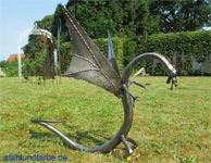 Garden Sculpture dragon from welded and forged sheet steel.
