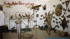 Photography of our exhibition stand of the art article on the Biota, environmental fair of Hamburg: Scrap iron plate recycling for the art 1992.