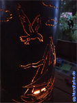 Pillar for barbecue-bowl with cut out with maritime contours as well as interior illumination.