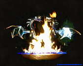 Steel dragons in the fire on the rotary stage