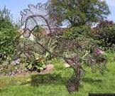 Wire horse garden Sculpture with peat and grass seed filled.